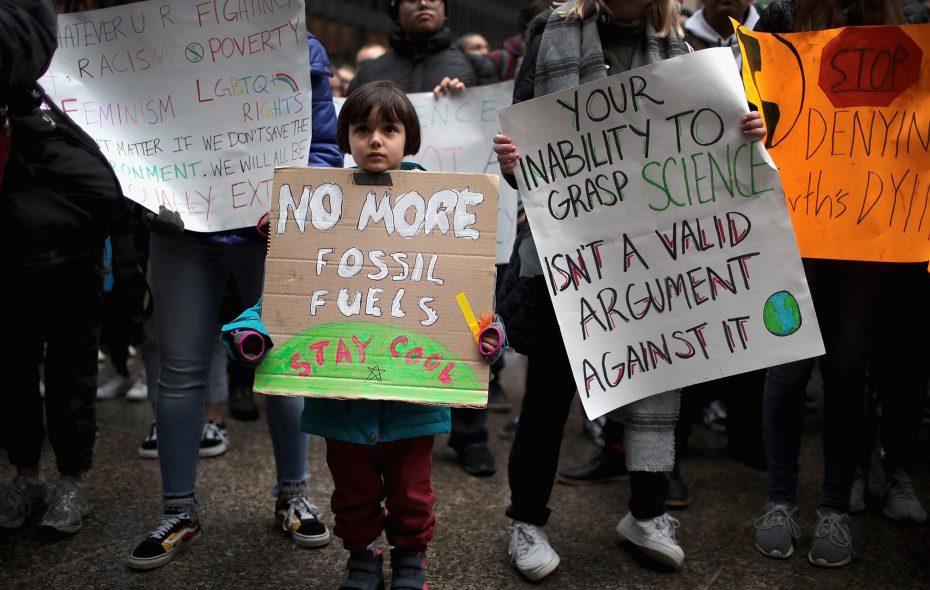 "Students and activists participate in a climate change ""strike"" on March 15, 2019 in Chicago, Illinois.  The strike was part of an international student movement to draw attention to climate change. Similar strikes took place in more than 100 countries. (Getty Images)"