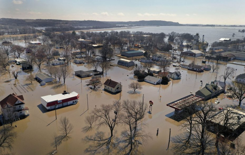 """Homes and businesses are surrounded by floodwater Wednesday  in Hamburg, Iowa. Several Midwest states are battling some of the worst flooding they have experienced in decades as rain and snow melt from the recent """"bomb cyclone"""" has inundated rivers and streams. (Getty Images)"""