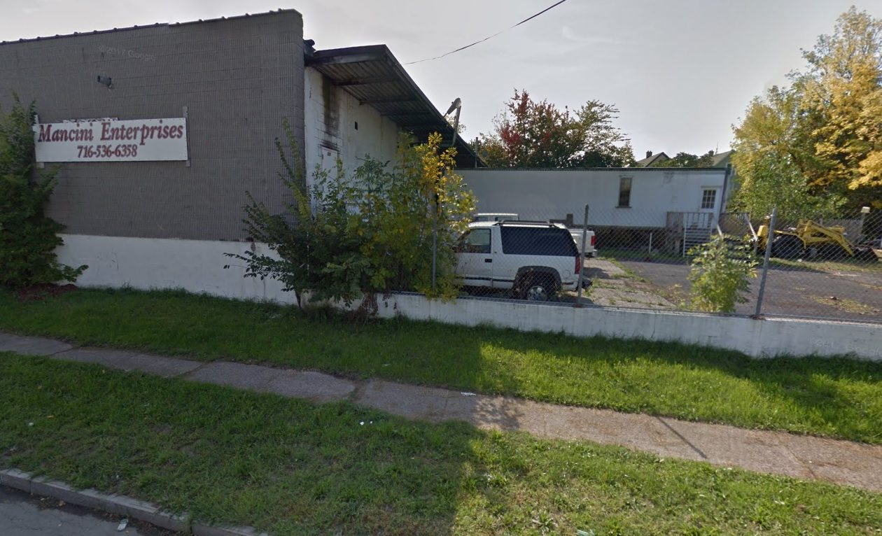 Rocco Termini wants to demolish this aging concrete building and replace it with a 118-space parking lot to support his nearby business incubator projects. (Google)