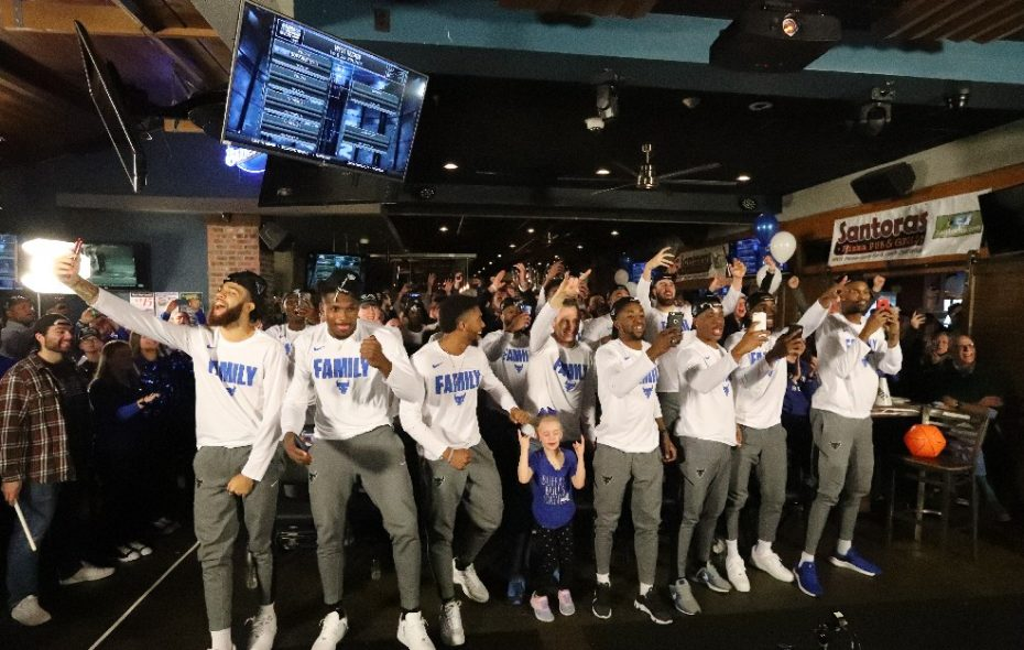 The Buffalo Bulls celebrate Sunday after finding out that they are going to the first round of the NCAA basketball tournament. (James P. McCoy/Buffalo News)
