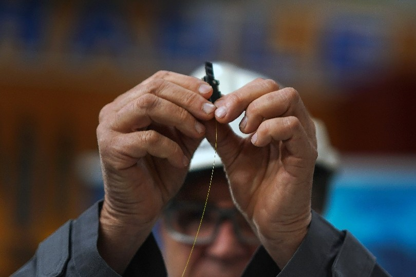 A worker holds a glass strand that will be woven into a fiber-optic cable at factory in New Hampshire. Erie County Executive Mark C. Poloncarz proposes to borrow money to extend broadband internet to areas of the county the lack it. The work is essential, though the county should take it on only if the private sector cannot be induced to do it. (New York Times)