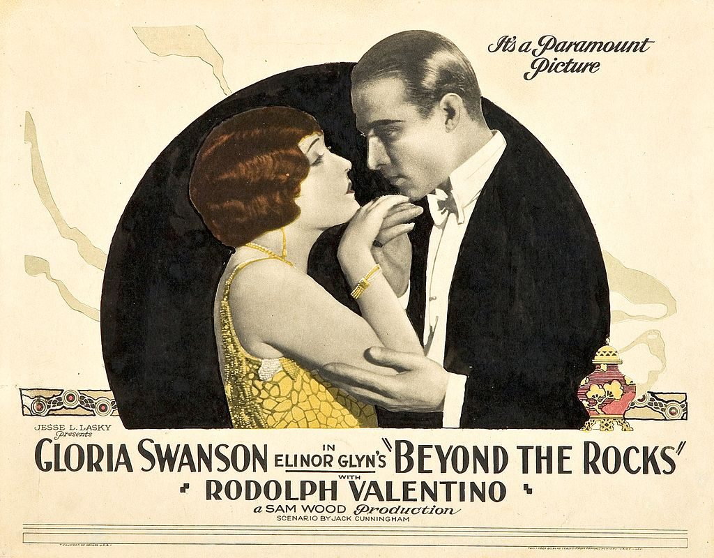 Gloria Swanson with Rudolph Valentino in a poster for the 1922 romantic film drama, 'Beyond the Rocks'