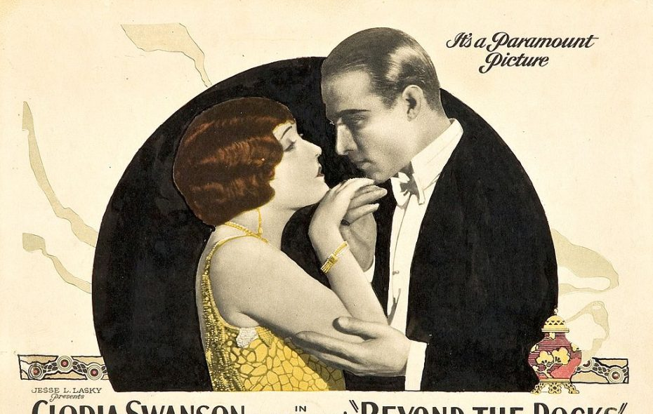"Gloria Swanson with Rudolph Valentino in a poster for the 1922 romantic film drama, ""Beyond the Rocks"""