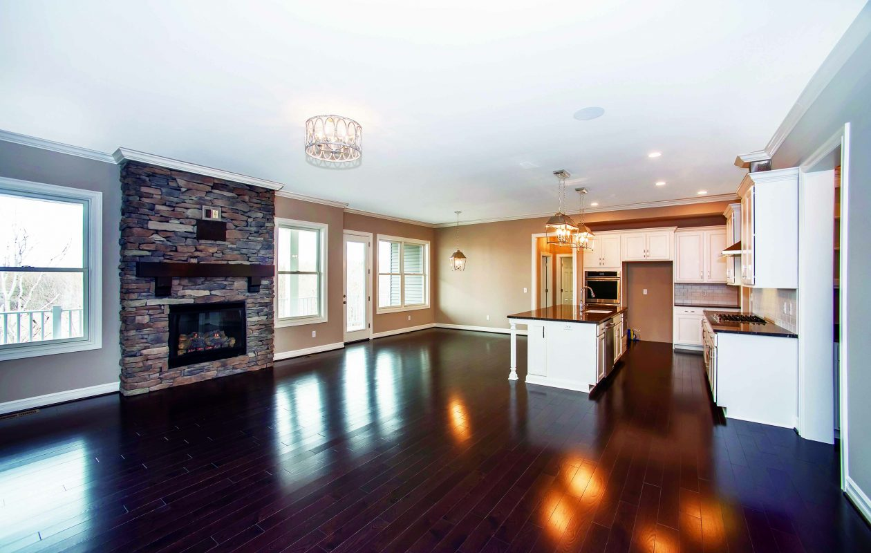 The main living area of the home at 36 Hampton Court in Orchard Park has a door that leads to the large back deck.