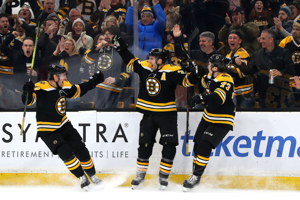 Boston's Patrice Bergeron (middle) celebrates his game-winning goal in the final seconds Thursday against Florida with John Moore, left, and Charlie McAvoy (73).    (Getty Images).