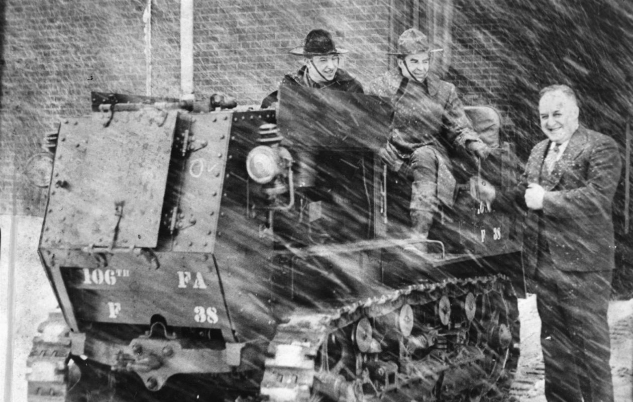 Help removing the snow from the 1936 St. Patrick's Day storm came from the 106th Field Artillery. Col. Douglas P. Walker stands next to the tractor and Leon Schultz and Cortez Peacock sit atop the tractor.(News file photo)