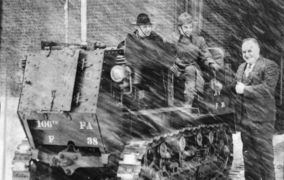 Help removing the snow from the 1936 St. Patrick's Day storm came from the 106th Field Artillery. Col. Douglas P. Walker stands next to the tractor and Leon Schultz and Cortez Peacock sit atop the tractor.	(News file photo)
