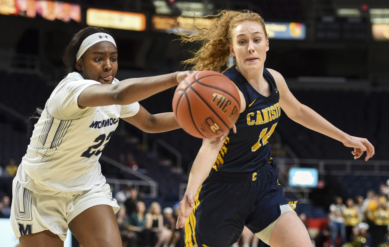Canisius' Sara Hinriksdottir and  Monmouth's Allure Simmons chase down a loose ball during a MAAC tournament quarterfinal (Cindy Schultz / For the Buffalo News)