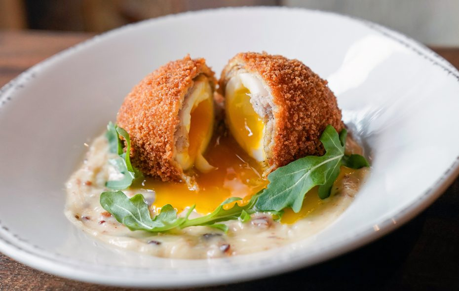Colter Bay's take on a British food staple, the Scotch egg, is nestle in a maple-bacon aoili. (Dave Jarosz)