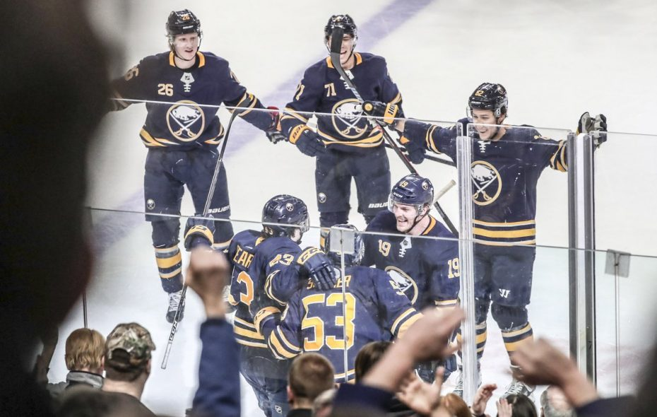 The Buffalo Sabres celebrate the overtime goal by left wing Conor Sheary (43) at KeyBank Center in Buffalo, NY on Friday, March 1, 2019. (James P. McCoy/Buffalo News)