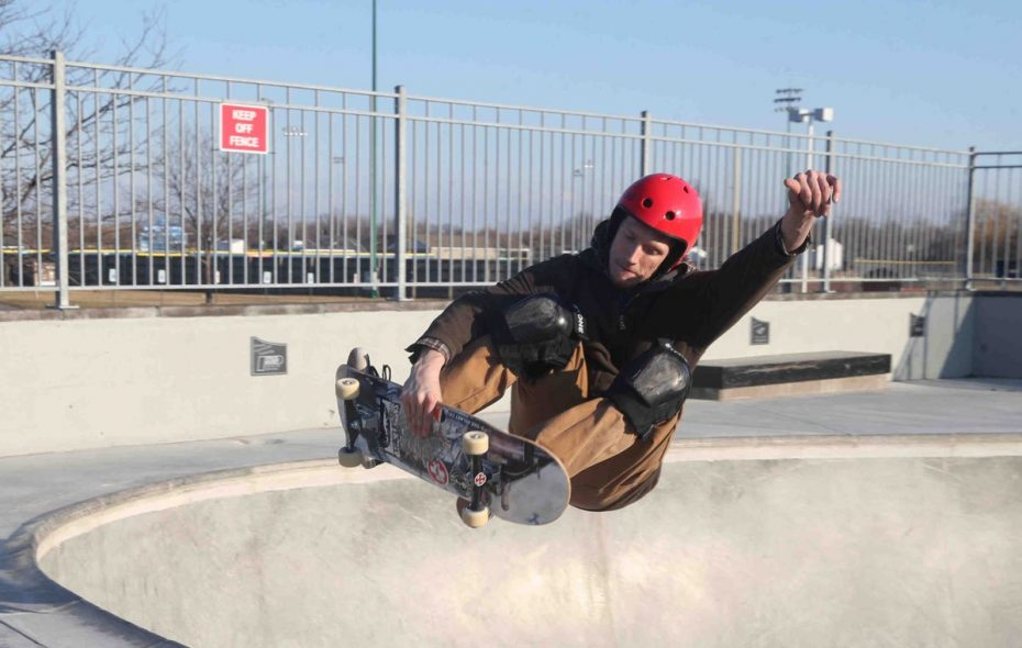 Quincy Koczka does a frontside air at Alix Rice Peace Park Skatepark, in Amherst, on Tuesday, as temperature were in the mid-40s. Wintry weather will return by week's end, forecasters said. (John Hickey/Buffalo News)
