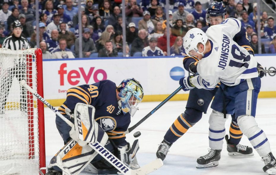 Sabres goaltender Carter Hutton (40) makes a save on a shot from Toronto Maple Leafs left wing Andreas Johnsson (18) in the second period at the  KeyBank Center in Buffalo, NY on Wednesday, March 20, 2019. (James P. McCoy/Buffalo News)