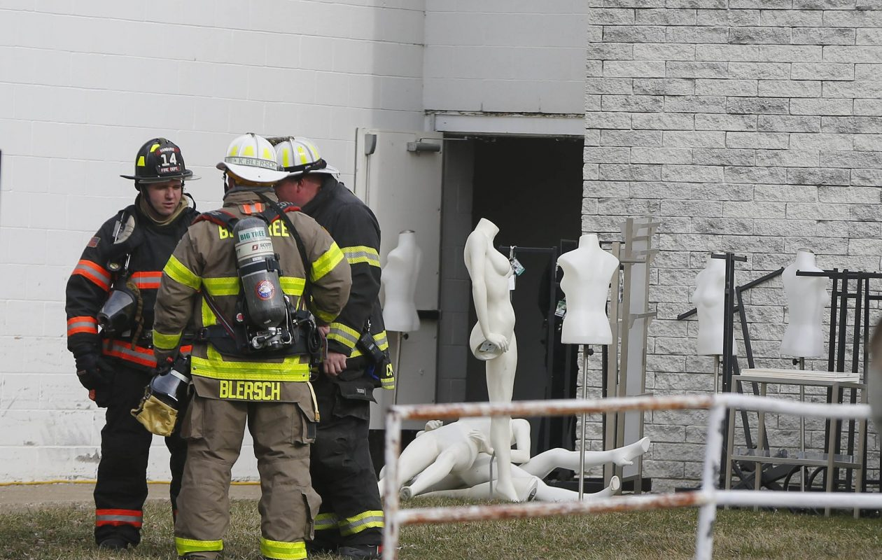 Firefighters from several crews battled a fire at New York & Co. at the McKinley Mall. (Mark Mulville/Buffalo News)