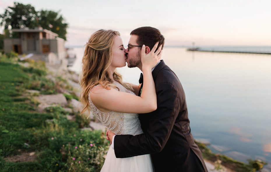 Emily and Mike were drawn to the blank canvas that the Fontana Boathouse provided for their wedding—not to mention the striking waterfront views. (Shaw Photography Co.)