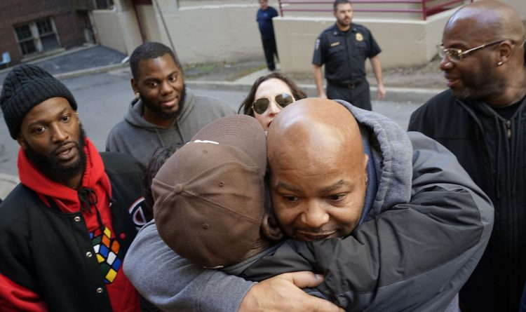 Cory Epps, who spent almost 20 years in prison for a murder he didn't commit, is mobbed by family on Dec. 1, 2017 as he is released from custody after his conviction was vacated in light of new evidence. (File photo/Derek Gee/Buffalo News)