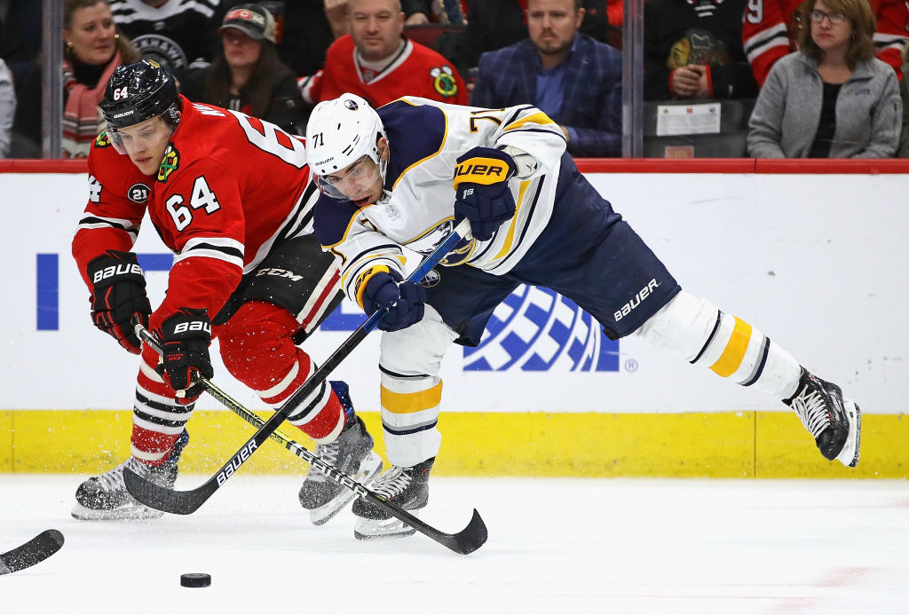 Evan Rodrigues, who had two assists Thursday, battles for the puck with Chicago's David Kampf. (Getty Images)