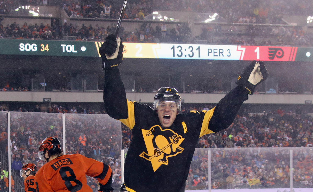 Pittsburgh's Evgeni Malkin celebrates his goal in the rain at the Stadium Series game last month in Philadelphia. (Getty Images)