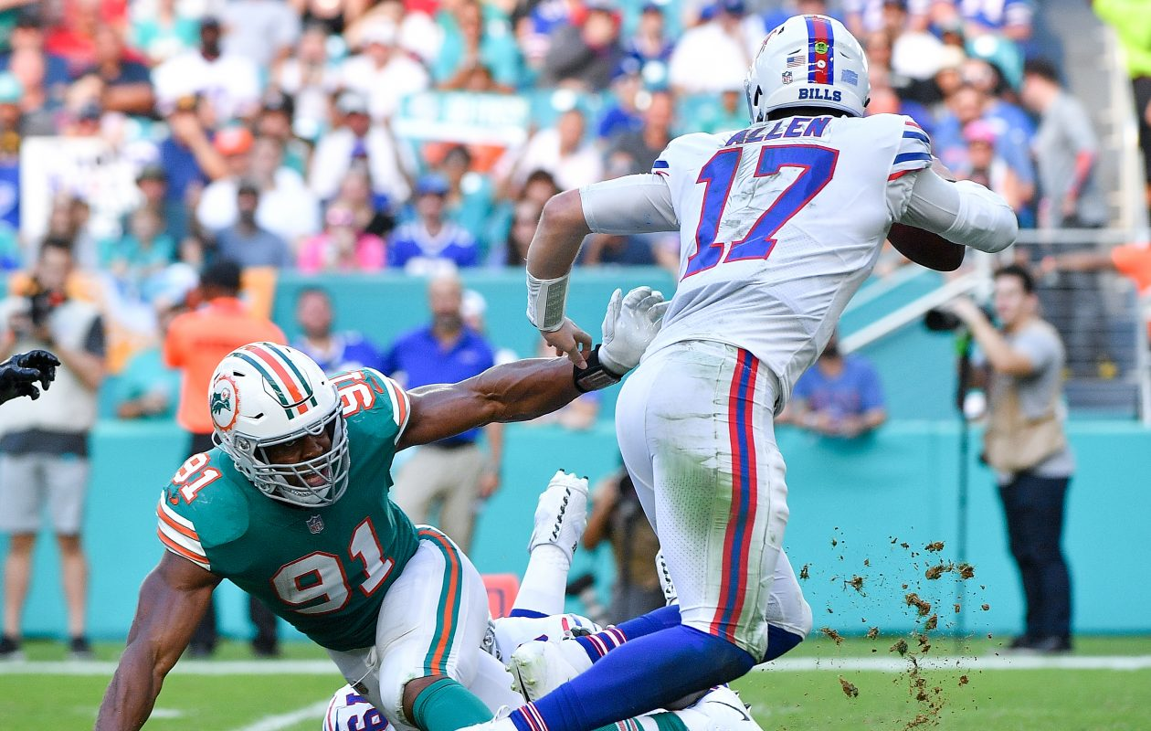 Dolphins pass rusher Cam Wake, seen here pressuring Bills quarterback Josh Allen, looks like he'll be playing for a new team in 2019. (Getty Images)