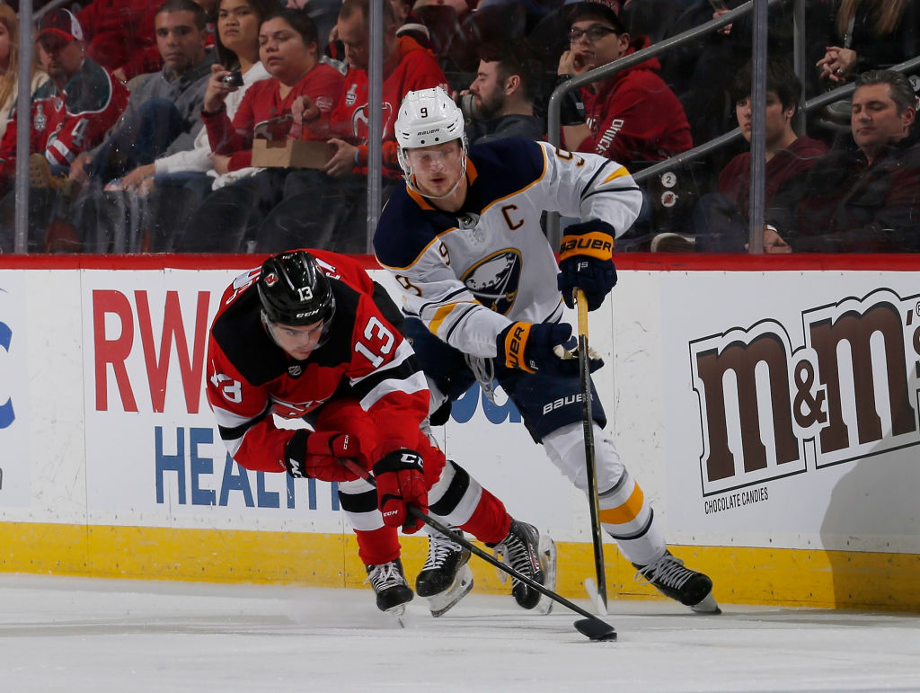 3f235a92550 Devils center Nico Hischier and Sabres center Jack Eichel battle for a  loose puck Monday night