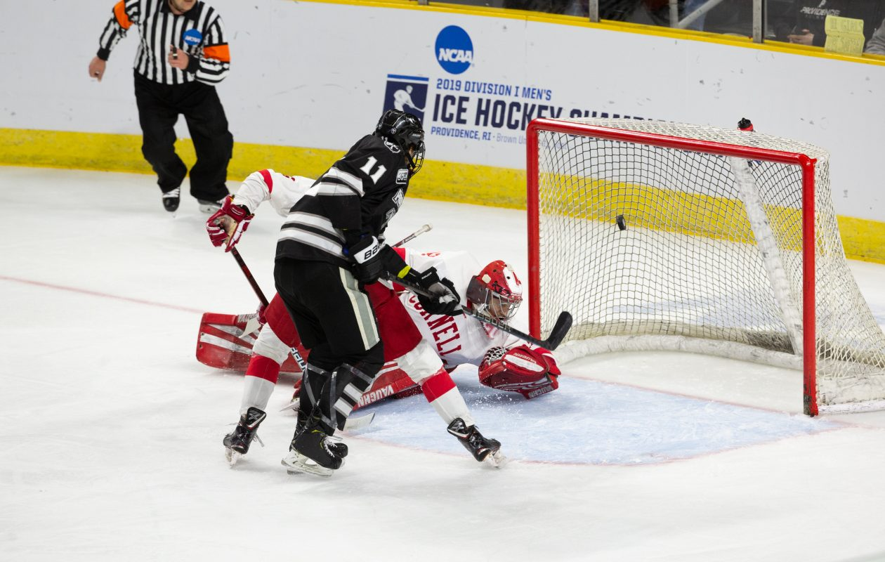 PROVIDENCE, RI - MARCH 31: Greg Printz #11 of the Providence College Friars scores a goal against Austin McGrath #32 of the Cornell Big Red during the NCAA Division I Men's Ice Hockey East Regional Championship Final at the Dunkin' Donuts Center on March 31, 2019 in Providence, Rhode Island. (Getty Images)
