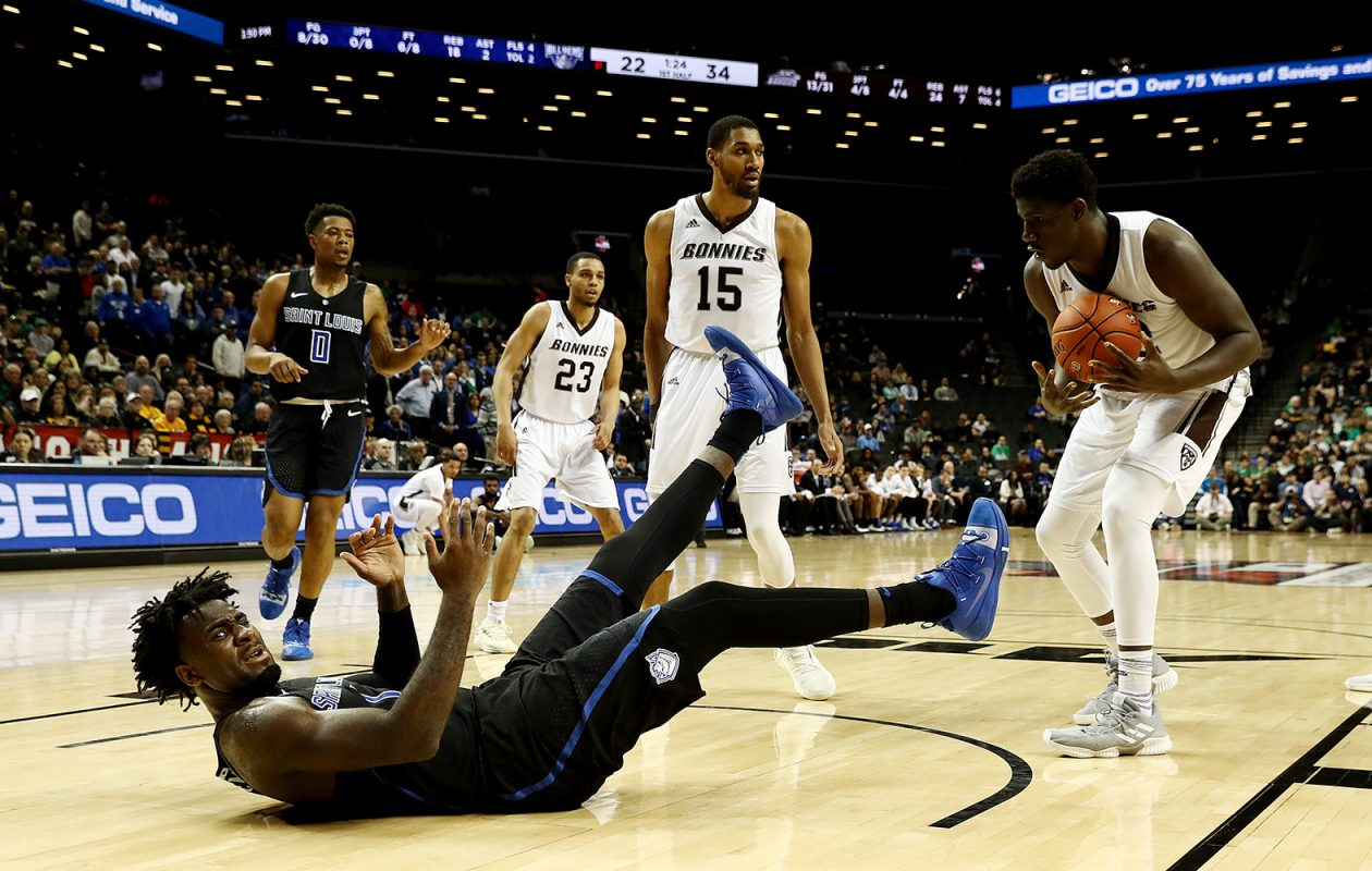 D.J. Foreman of Saint Louis falls to the ground against Amadi Ikpeze of the St. Bonaventure during the Atlantic 10 championship game at Barclays Center on March 17. (Al Bello/Getty Images)