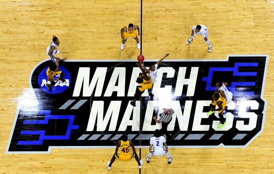 Opening tip off between Montell McRae of Buffalo and Romello White of Arizona State during the first round of the 2019 NCAA Division 1 Men's Basketball Championship at BOK Center on March 22, 2019 in Tulsa, Oklahoma. (Photo by Harry How/Getty Images)
