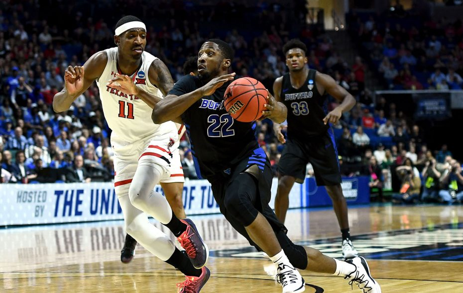 Dontay Caruthers drives past Tariq Owens of Texas Tech. (Stacy Revere/Getty Images)