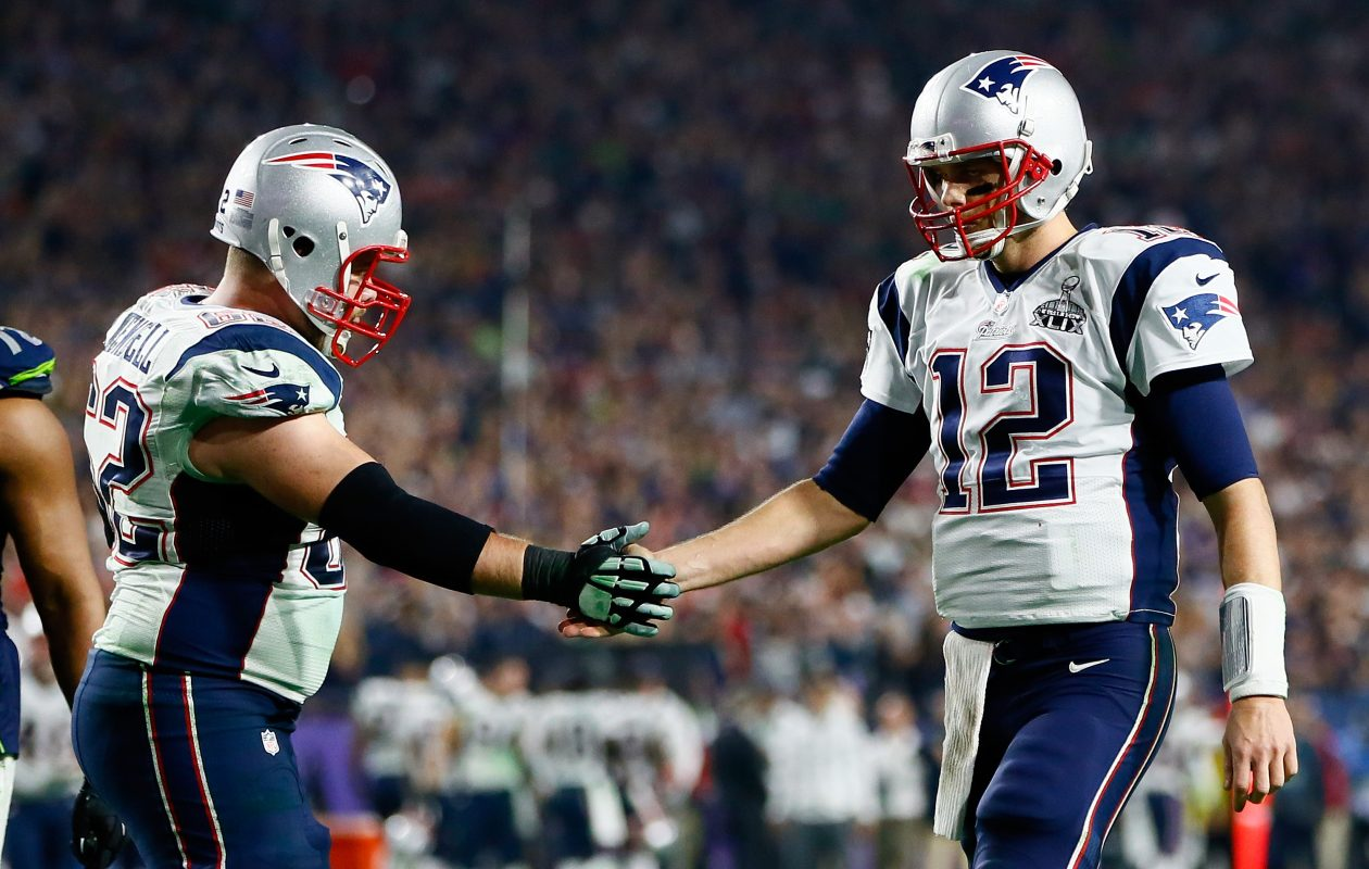 Former Patriots center Ryan Wendell (left) has joined the Bills' coaching staff. (Kevin C. Cox/Getty Images)