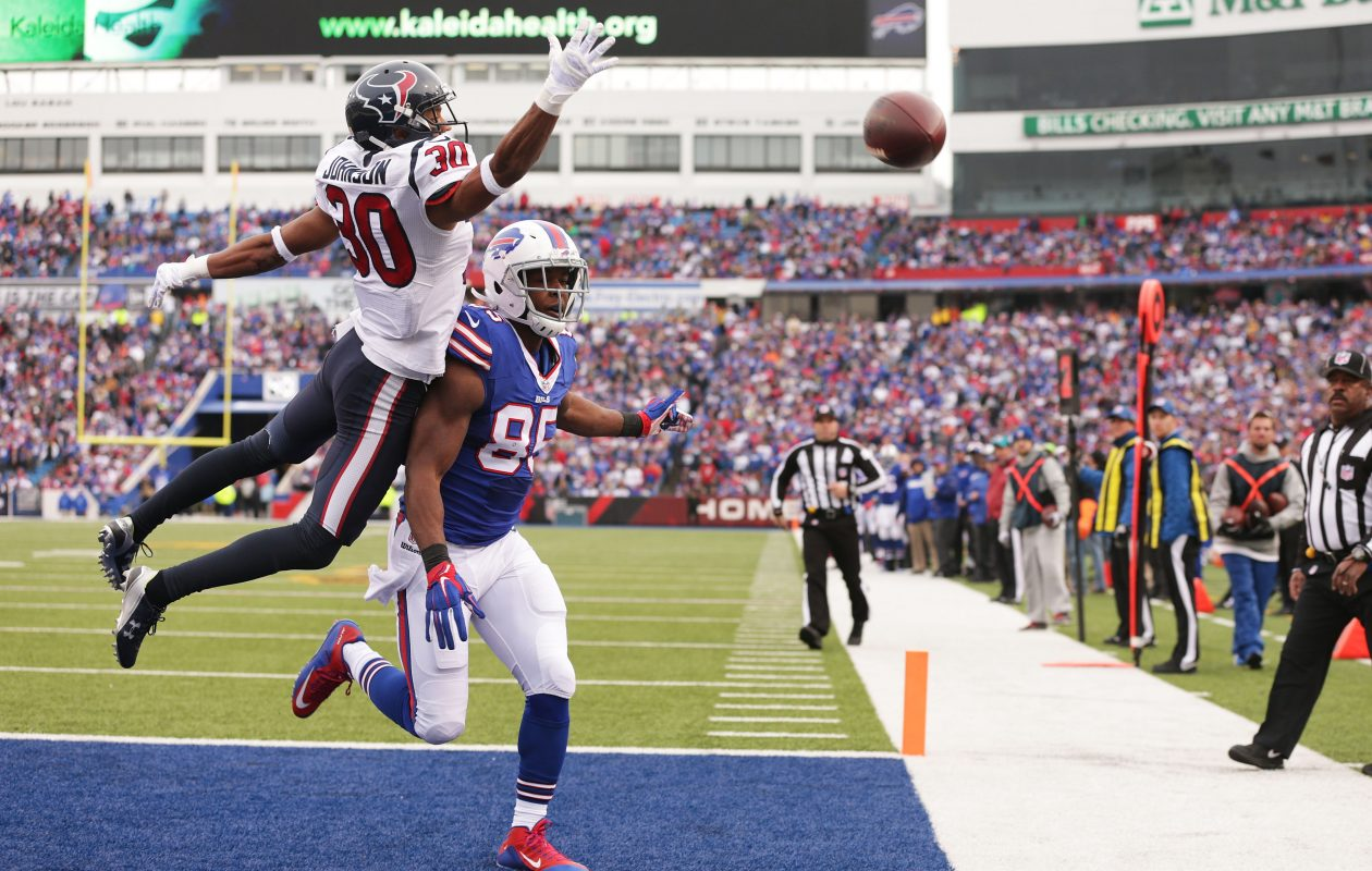 Former Texans cornerback Kevin Johnson makes a play on the ball while defending ex-Bills tight end Charles Clay during a game in Buffalo in 2015. (Getty Images)