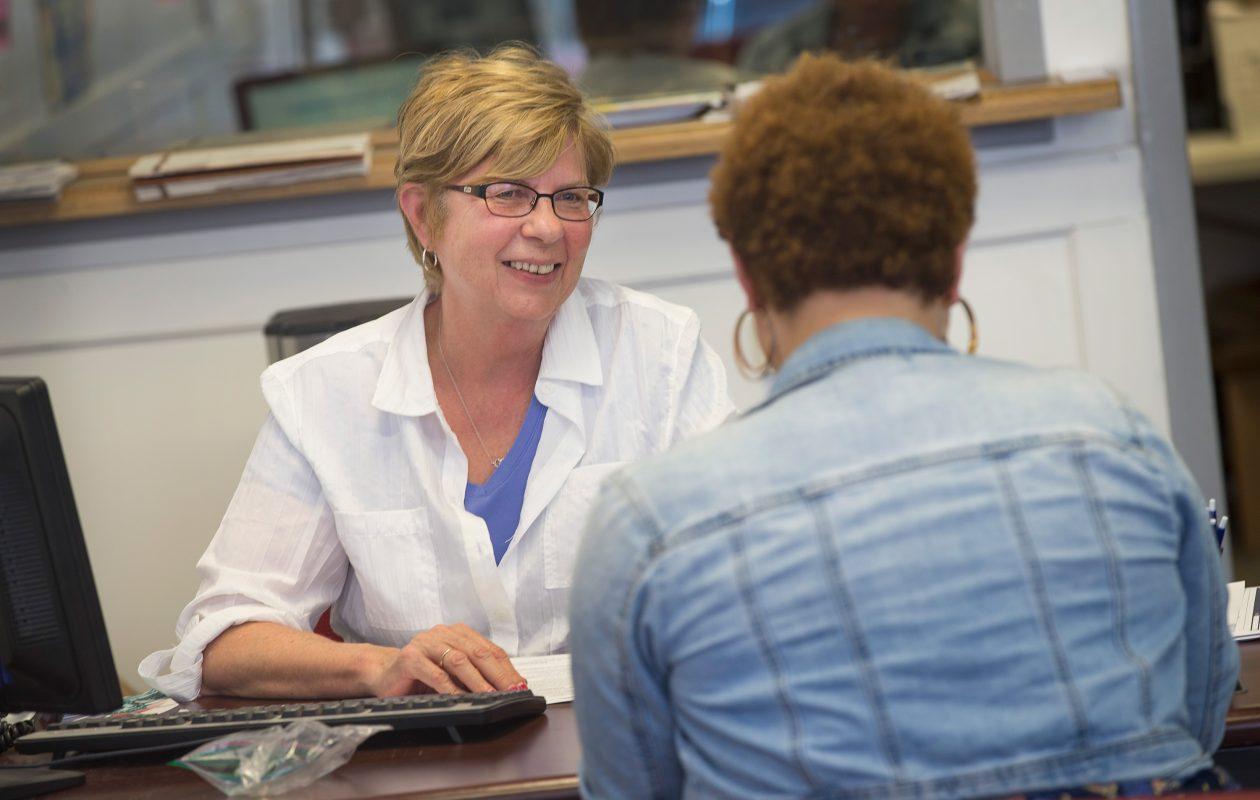 Roberta Vesperman helps a customer prepare her taxes. (Scott Olson/Getty Images)