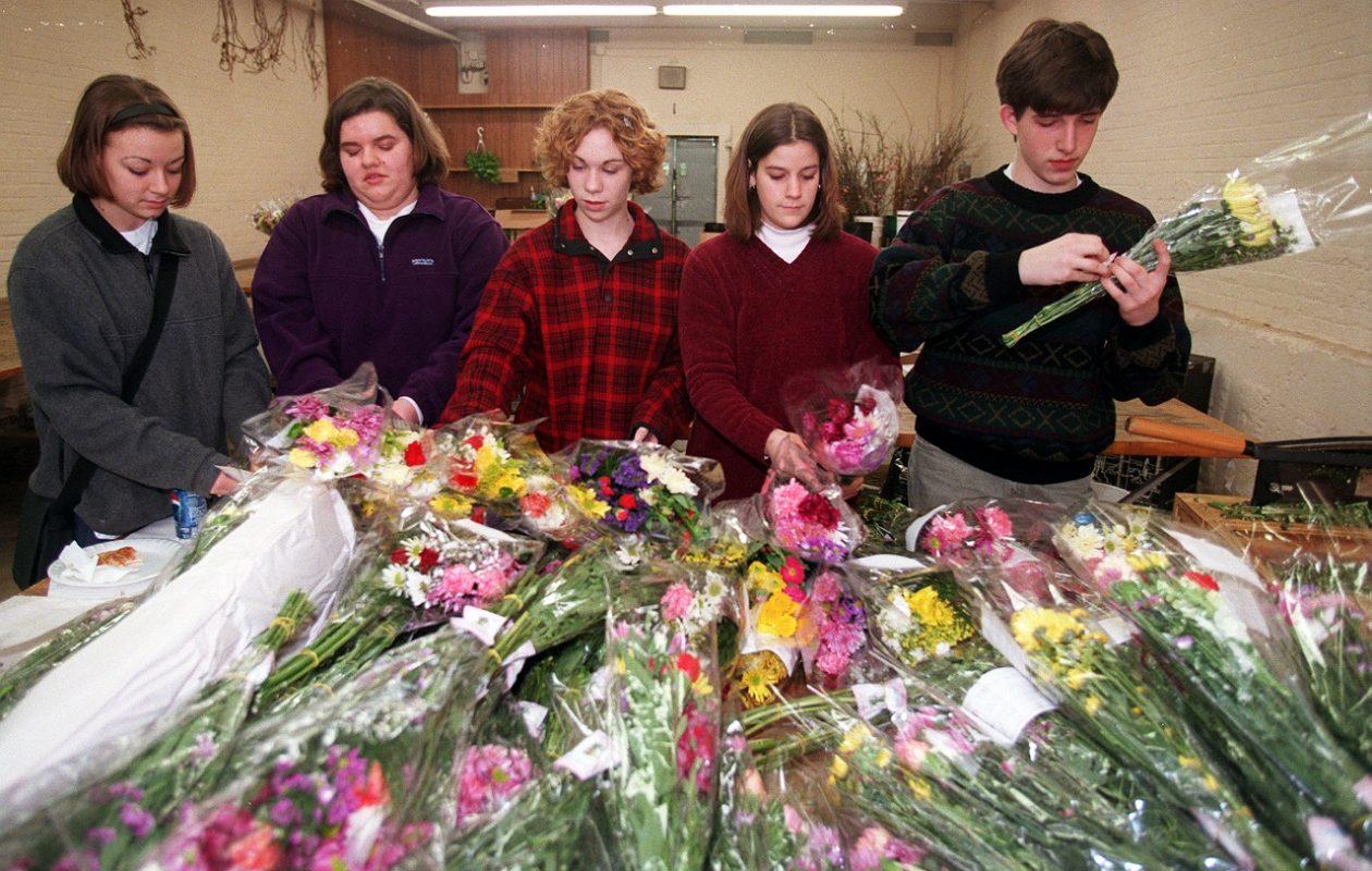 Kenmore West High School students help assemble arrangements for a previous Hospice Buffalo Bouquet Sale. This year's sale starts Monday. (Robert Kirkham/News file photo)