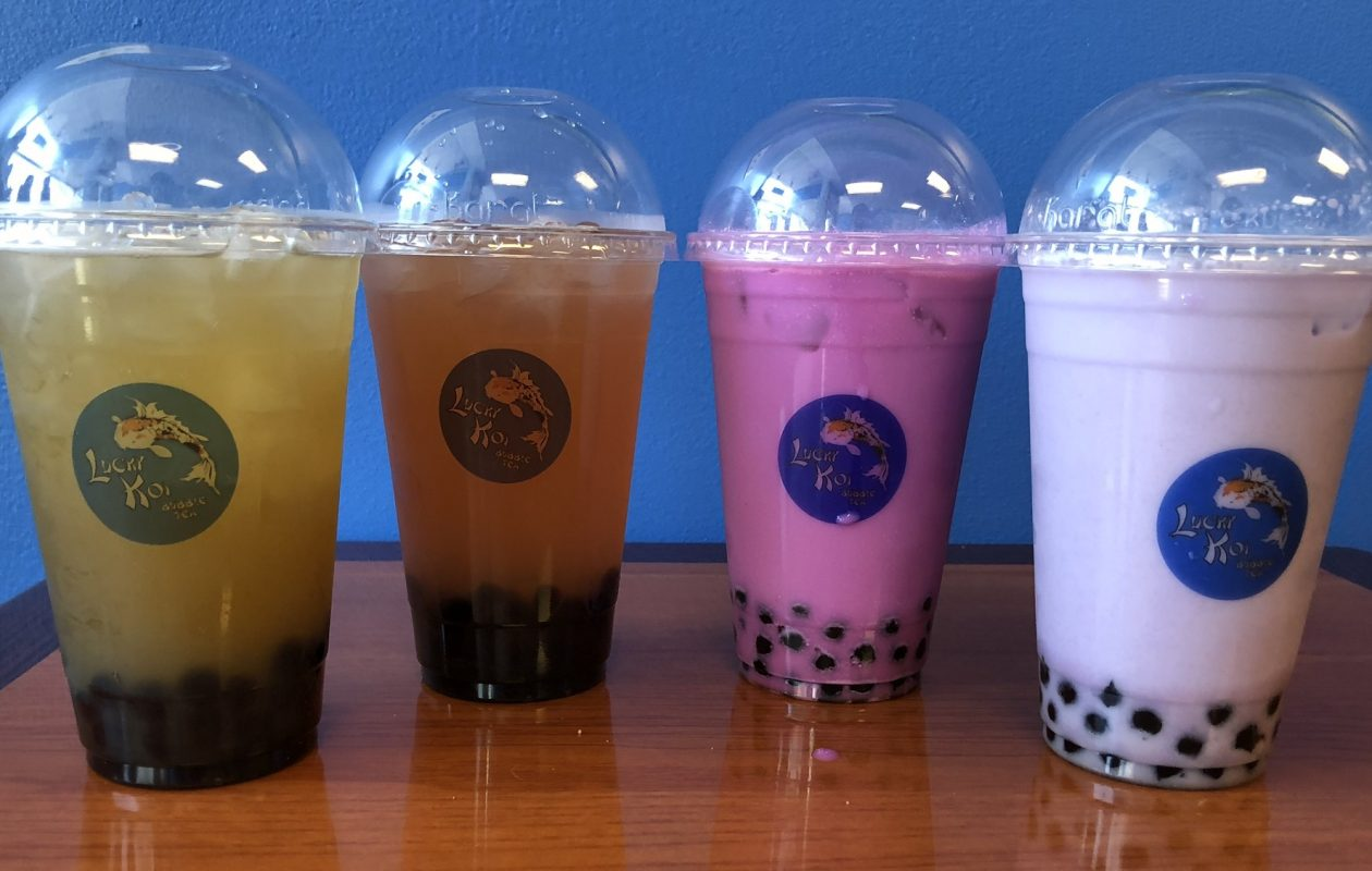 Four bubble teas from Lucky Koi, identified from left: Freshly crushed sugar cane, shiso plum with white tea, milky ube tea with oolong, and taro bubble tea with green tea. (Ben Tsujimoto/Buffalo News)