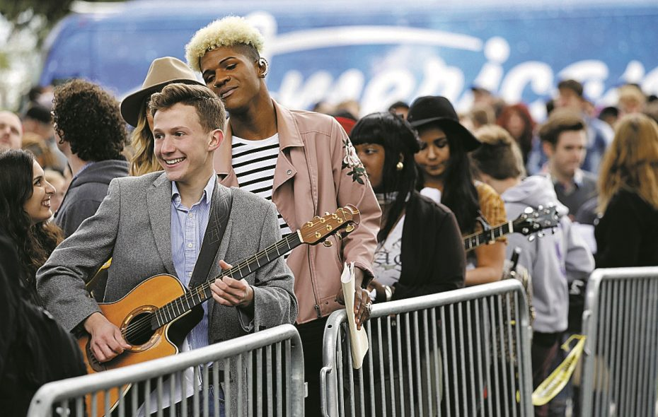 "John Cimino of Lewiston plays guitar as he waits in line in September to audition for ""American Idol"" at Canalside. (Derek Gee/Buffalo News)"