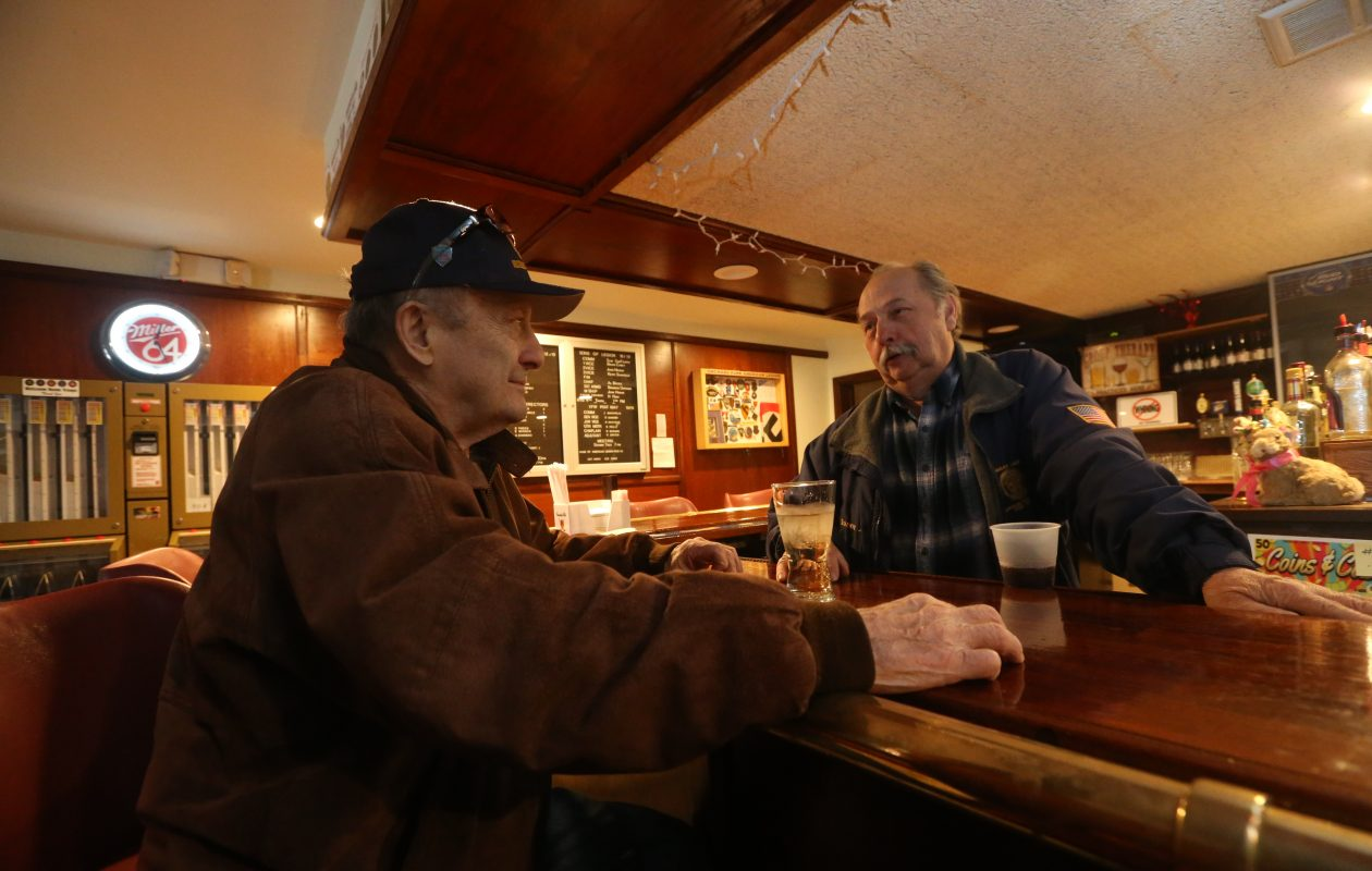 Post Commander Joe Cash, left, chats with Danny 'J' Jakubowicz at the American Legion Post 567 at 3740 North Buffalo St. in Orchard Park, on Friday, March 29, 2019, The building is for sale due to dwindling participation. (John Hickey/Buffalo News)