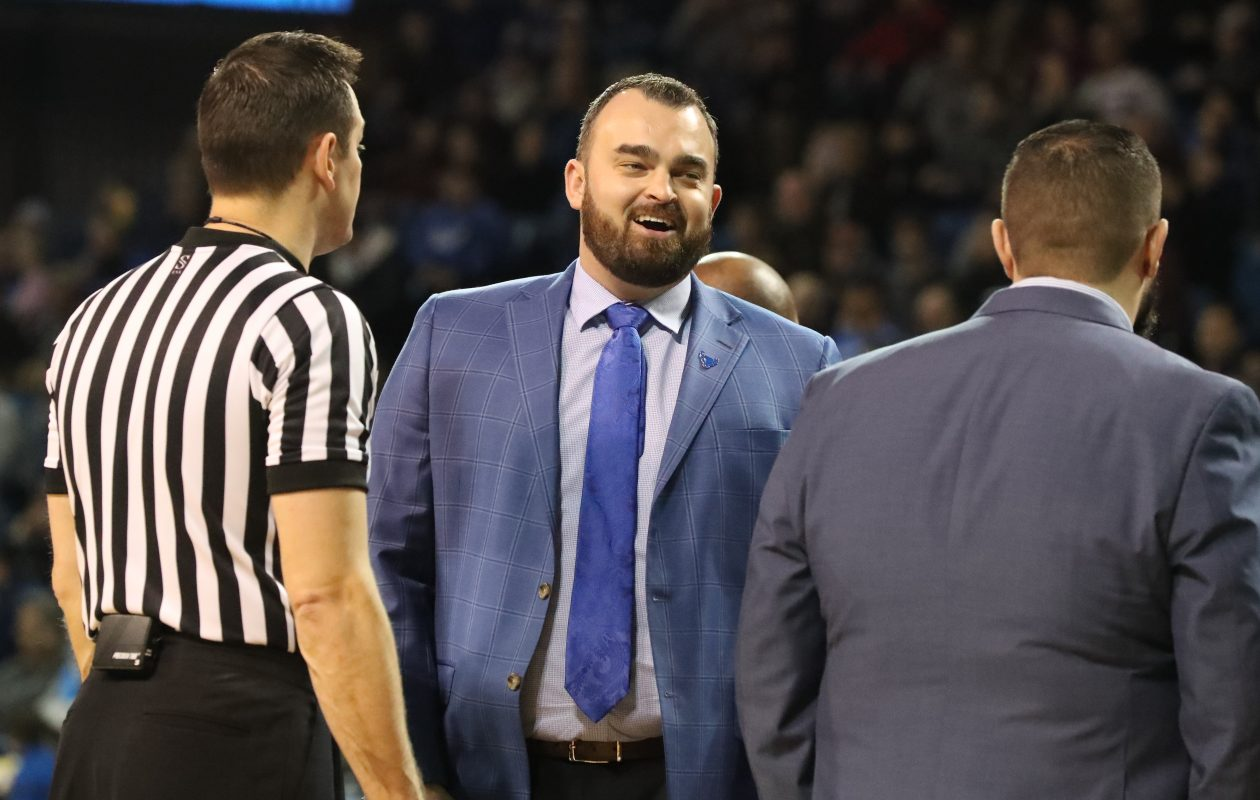 UB assistant coach Bryan Hodgson, center. (James P. McCoy/Buffalo News)