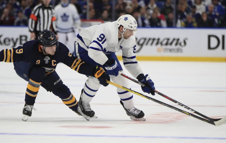 Sabres captain Jack Eichel tries to get the puck from Leafs star John Tavares during the teams' meeting in Buffalo on Dec. 4 (Harry Scull Jr./Buffalo News).
