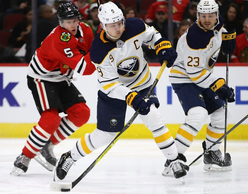 Jack Eichel shoots the puck in front of Chicago's Connor Murphy as Sam Reinhart looks on (Getty Images).