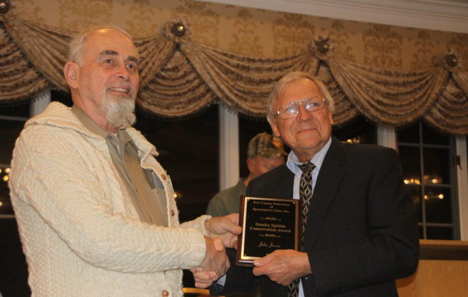 John Jarosz, right, of Lake View is presented the Stan Spisiak Conservationist Memorial Award by Frank Miskey for his work through the Niagara Musky Association. (Bill Hilts Jr./Buffalo News)