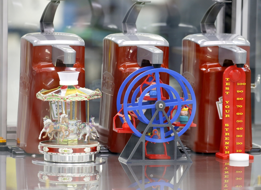 """What is believed to be the world's first, practical use """"ketchup dispensing robot"""" was officially unveiled at last year's fair at the """"I-Hub at the Fair"""" series of exhibits and experiences. (Robert Kirkham/Buffalo News)"""