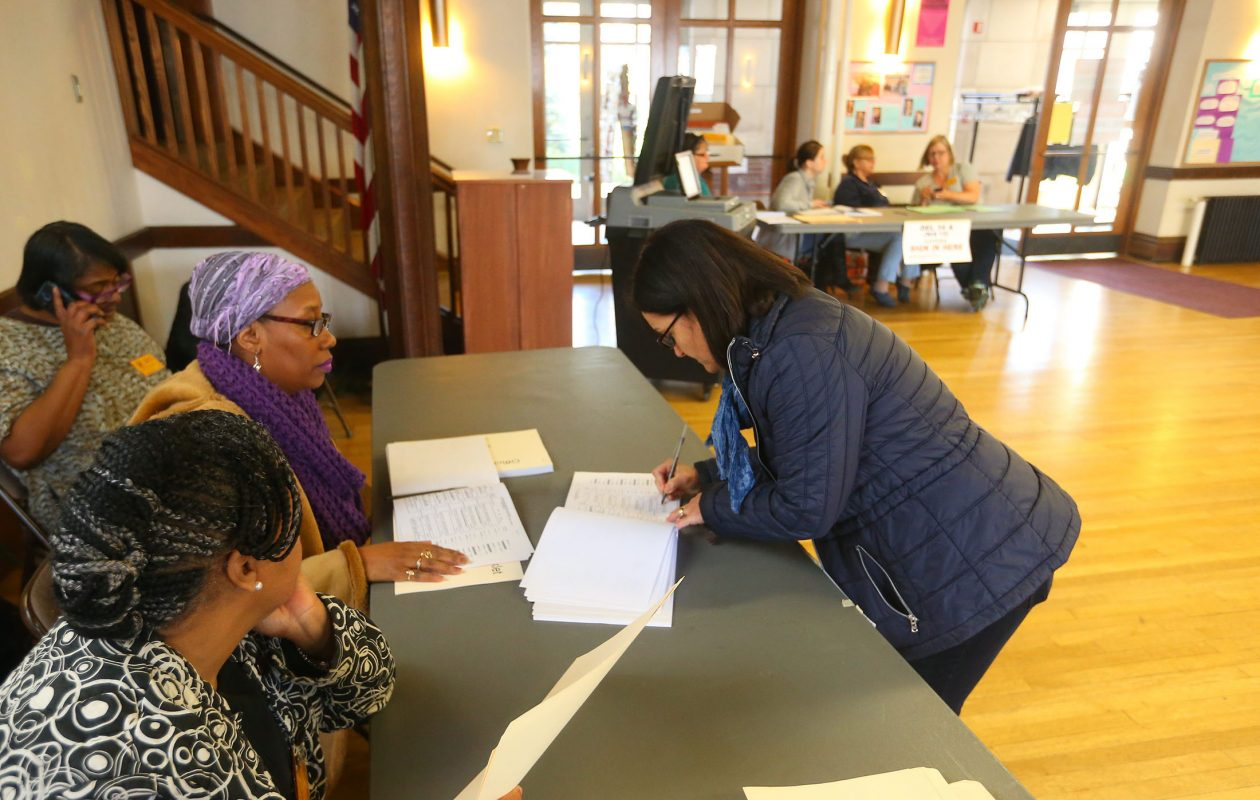 A voter signs in at the  Unitarian Universalist Church in Buffalo to cast her ballot in the Buffalo School Board election in 2016.  (John Hickey/Buffalo News file photo)