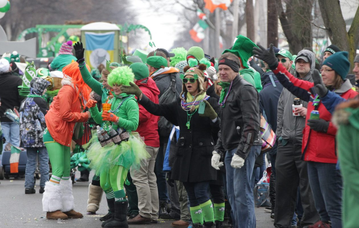 There were  winter coats and hats in evidence as thousands watched the Old Neighborhood Parade on March 15, 2014.  (James P. McCoy/ Buffalo News file photo)