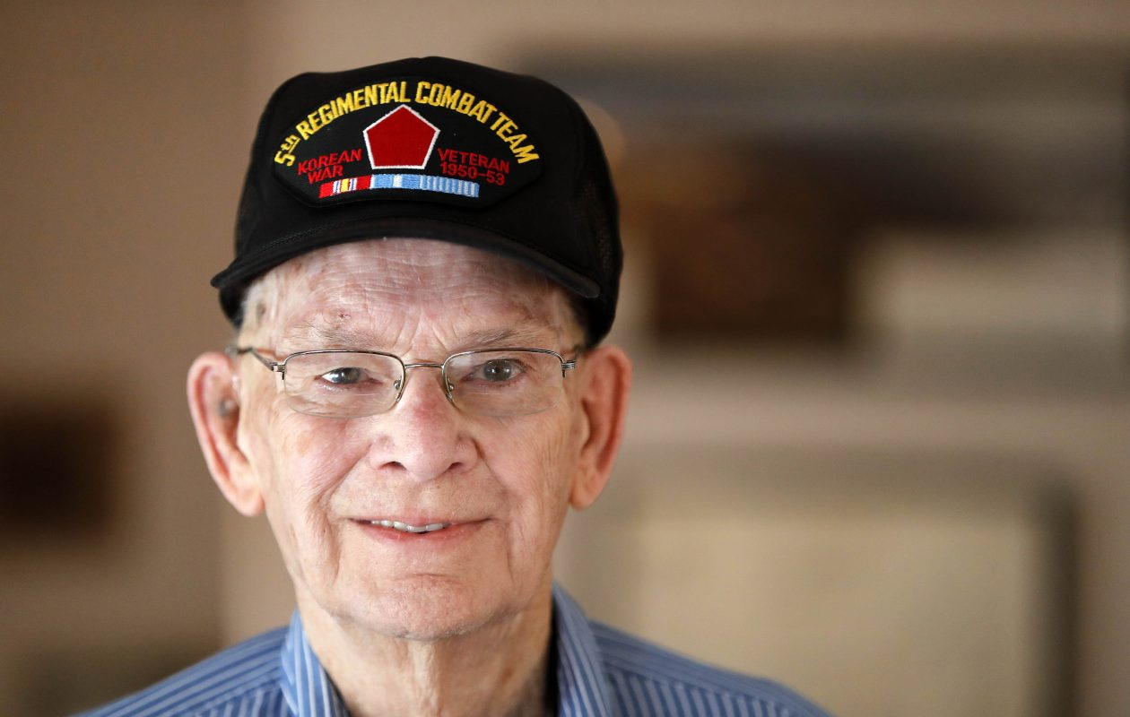 Paul R. Garland served in the U.S. Army in Korea during the Korean War. He said he was hit by shrapnel in the leg while using his body to shield a Korean mother and her children from shelling. (Mark Mulville/Buffalo News)