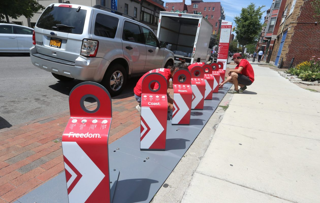 Workers from Reddy Bikeshare install a station on Allen Street  in Buffalo, on July 20, 2016.  (John Hickey/News file photo)