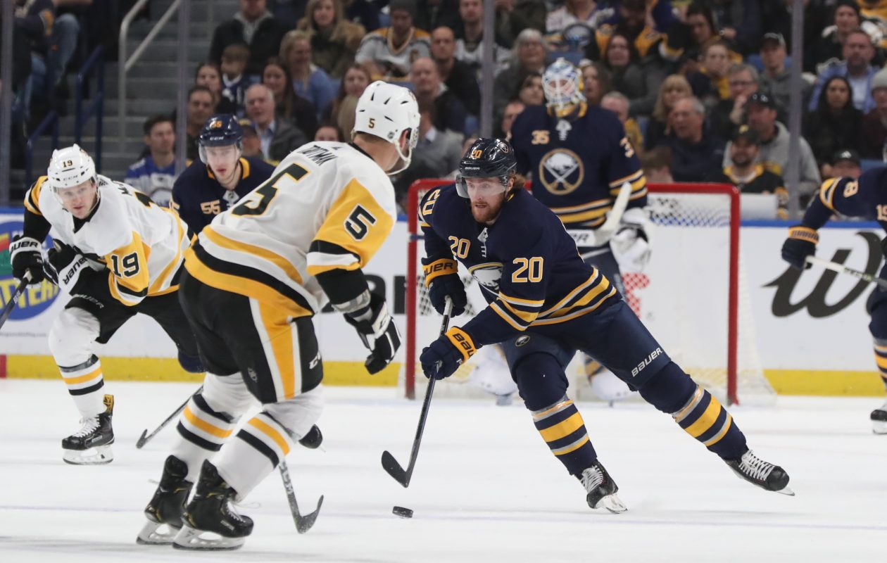 Sabres left wing Scott Wilson (20) battles Pittsburgh Penguins defenseman Zach Trotman (5) for the puck in the first period. (James P. McCoy/Buffalo News)