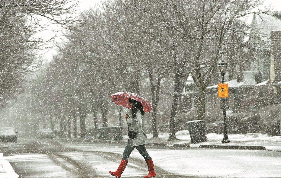 Heather Stone crosses Shepard Avenue in Kenmore while walking down Delaware Avenue in heavy snow on March 26, 2015. (Derek Gee/Buffalo News)