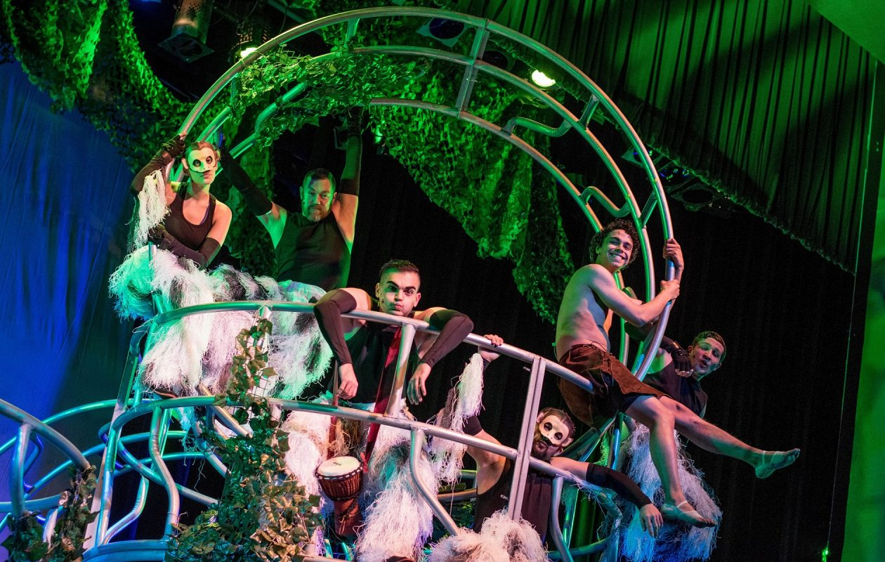 The cast the Theatre of Youth's 'The Jungle Book' peers out from the creative  jungle gym-like set at the Allendale Theatre.