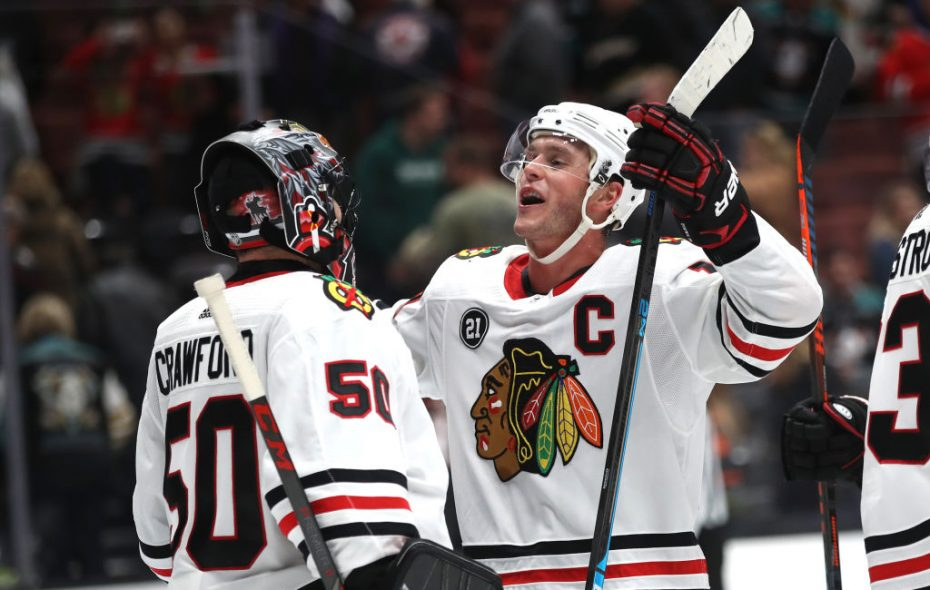 Jonathan Toews and goaltender Corey Crawford celebrated a win in Anaheim on Feb. 27, but the Blackhawks lost the other two games of their Western trip. (Getty Images)