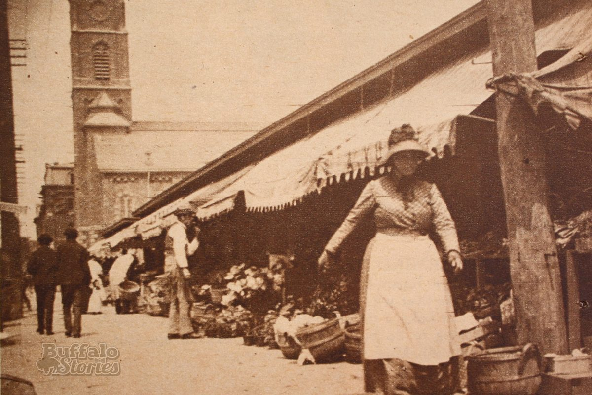 Shopping at the Washington Street side of the Washington Market, with St. Michael's Church in the background. (Buffalo Stories archives)