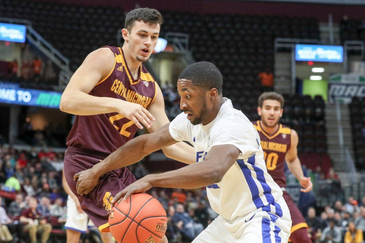 UB guard Dontay Caruthers is fouled by Central Michigan's Matt Beachler in the first half of the MAC Tournament semifinals Friday at Quicken Loans Arena in Cleveland. (James P. McCoy/The Buffalo News)