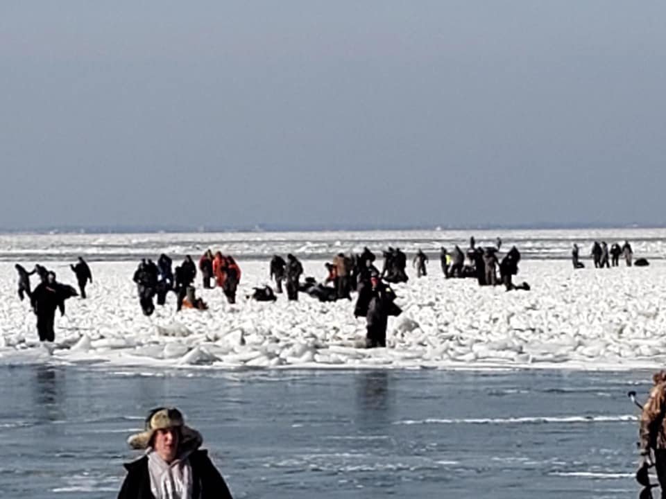 Lake Erie ice fishermen wait for help Saturday  off Catawba Island in Ohio (Photo by U.S. Coast Guard Sector Detroit)